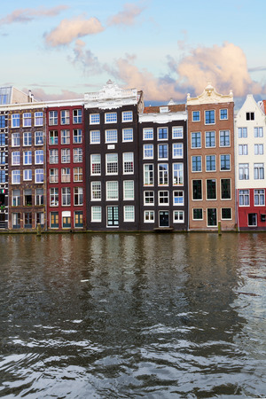 facades of historic buildings over canal waters, Amsterdam, Netherlands photo