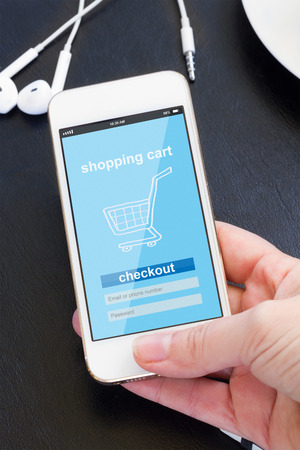 mobile shopping concept  - checking out in virtual shop on modern smat phone screen photo