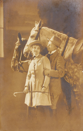 POLAND, WARSAW - CIRCA 1939 : old photo  of happy young romantic couple of woman and man with horses. Illustrative Image, subject of human interest0