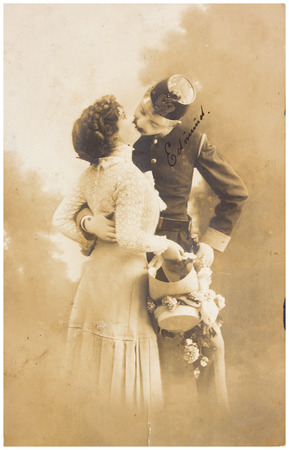 POLAND, WARSAW - CIRCA 1910: old photo  of kissing woman and man in military dress. Illustrative Image, subject of human interest