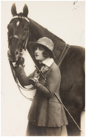 POLAND, WARSAW - CIRCA 1932 : old photo portrait of woman with horse. Illustrative Image, subject of human interest0