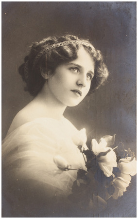 edwardian: POLAND, WARSAW - CIRCA 1913: old photo portrait of young woman with flowers. Illustrative Image, subject of human interest
