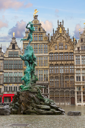 guildhalls: medieval Brabo fountain and old guildhalls houses, Antwerpen, Belgium Stock Photo
