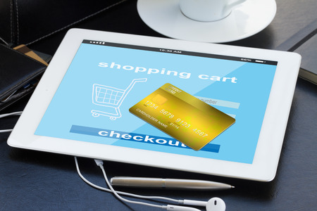 mobile shopping concept  - checking out in virtual shop on tablet PC photo