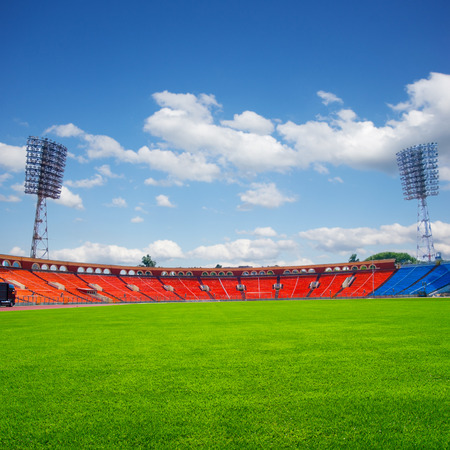 football field with green grass at sunny day