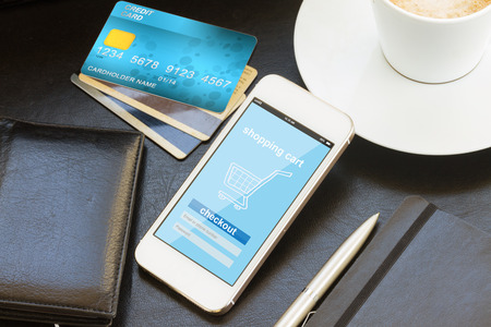mobile shopping concept  -  virtual shop on phone screen with credit cards and wallet Stock Photo