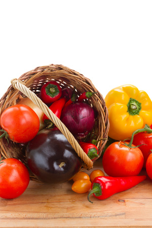fresh vegetables on table - tomatoes, onion, peppers and eggplants photo