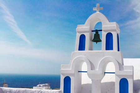 white and blue church belfry,  Santorini island, Greece photo