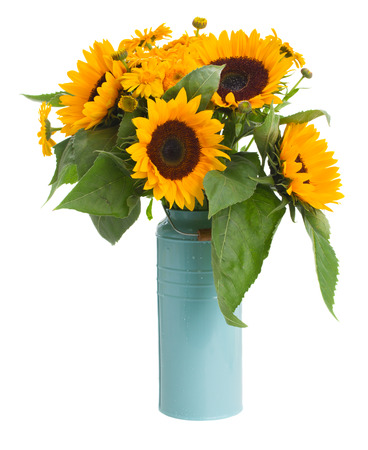 sunflowers and marigold flowers bouquet in blue pot isolated on white background photo