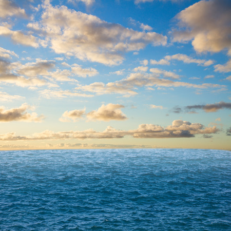beautiful seascape with deep  ocean  waters and surise cloudscape photo