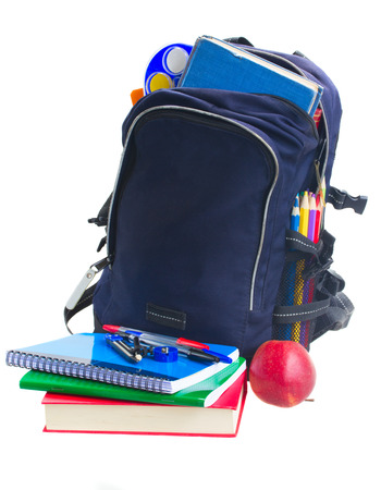 blue school open backpack with stationery and apple isolated on white  Stock Photo