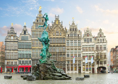 guildhalls: medieval Brabo fountain and old guildhalls houses at Grote Markt square, Antwerpen, Belgium