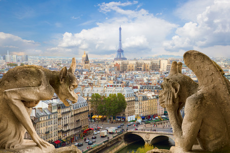 Gargoyle on Notre Dame Cathedral and city of  Paris, France photo