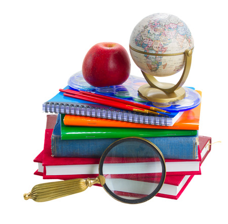 books with school supply, apple and globe isolated on white background photo