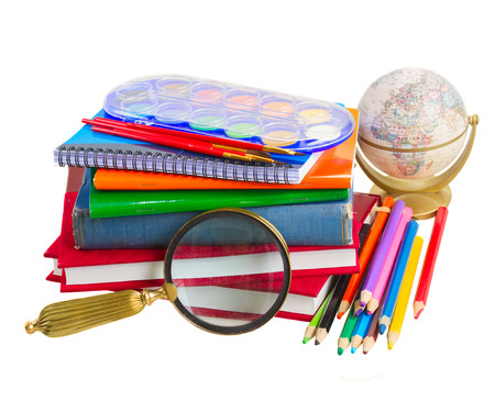 books with school supply, looking glass  and globe isolated on white background photo