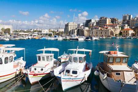 Heraklion old venetian harbour with colorful boats, Crete, Greece photo
