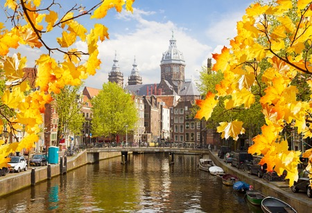 Church of St Nicholas, old town canal at fall day, Amsterdam, Netherlands photo