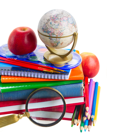 books with school supply, looking glass  and globe close up  isolated on white background photo