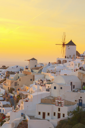 famouse sunset of Oia with windmill, Santorini  vertical shot, HDR photo