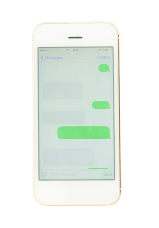 smartphone with empty sms clouds isolated in white background photo