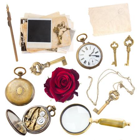 vintage set of loupe, clock, keys and old photos isolated on white background photo