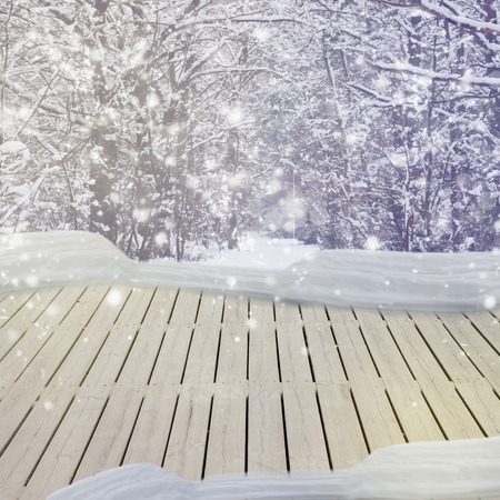 wooden planks in winter  forest  with  snow photo