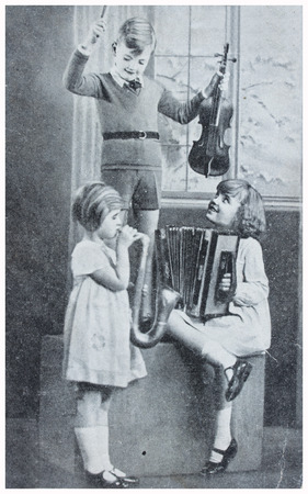 POLAND, WARSAW - CIRCA 1935: old photo of  kids with music instruments. Illustrative Image, subject of human interest