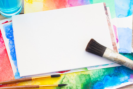 canva: white canva with frame of paints and brushes