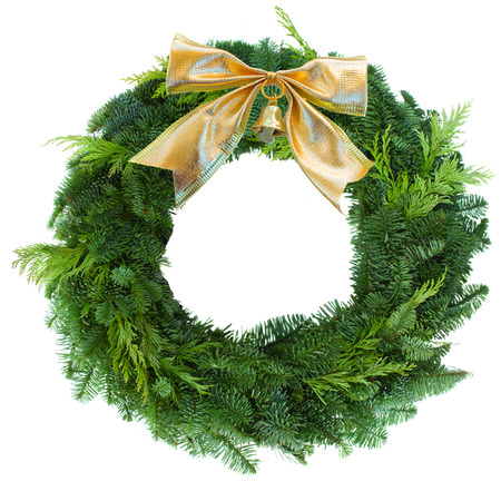 pine wreath: green christmas wreath woth golden bow  Stock Photo