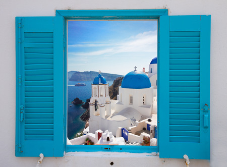 window with view of caldera  and church, Santorini 免版税图像