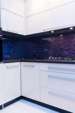violet residential: view of modern  white and violet kitchen