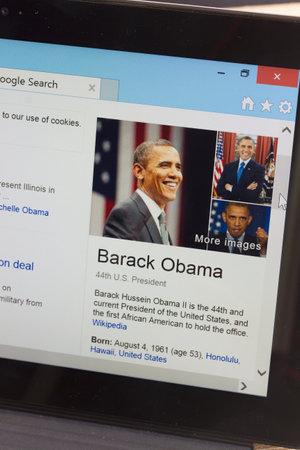 obama care: WARSZAWA, POLAND - OCTOBER 10, 2014.  Barack Obama WiKi page on screen of tablet.