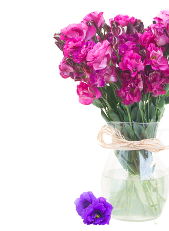 bunch of mauve eustoma flowers in vase close up  isolated on white photo