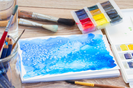 canva: canva with frame of paints and brushes Stock Photo