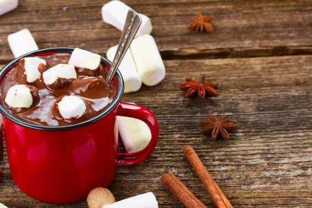 marshmallows: mug with  hot chocolate and marshmallows  on wooden table