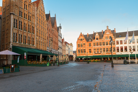 Historical medieval buildings on the Market Square, Brugge, Belgium photo