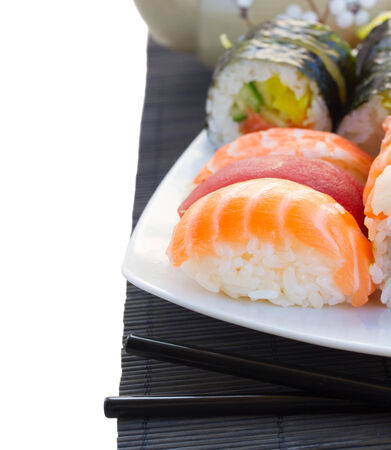 lunch with japaneese  sushi dish close up isolated on white background Banco de Imagens