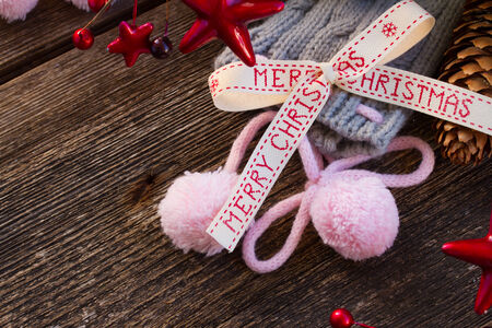 merry christmas bow with christmas decorations  and wool socks on wood photo