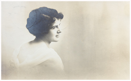 POLAND, WARSAW - CIRCA 1911: old photo portrait of young woman profile with copy space. Illustrative Image, subject of human interest Éditoriale