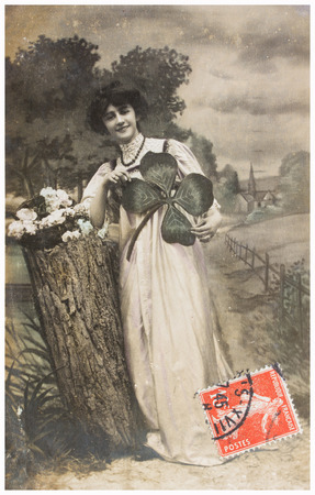 FRANCE, PARIS - CIRCA 1900s: old photo  of young woman in garden. Illustrative Image, subject of human interest