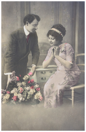 POLAND, WARSAW - CIRCA 1900s : old photo  of  young romantic couple of woman and man in spring garden. Illustrative Image, subject of human interest0