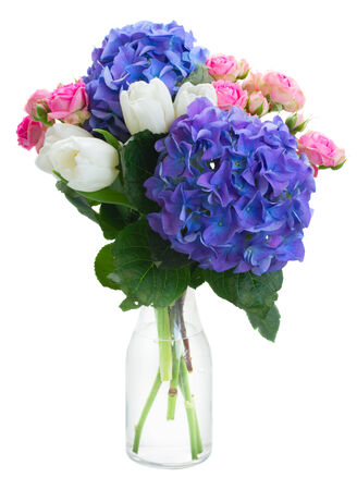 posy: posy   of white tulips, pink roses and blue hortensia flowers