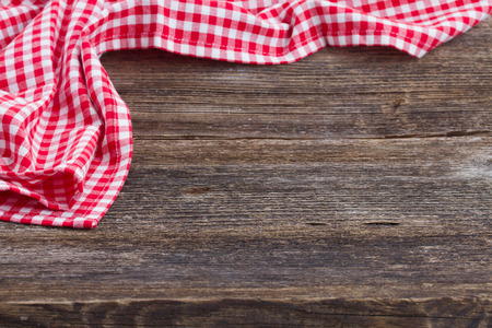 empty wooden table   and cloth red napkin