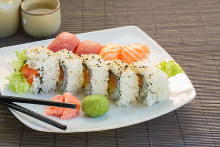 dinner with japaneese  sushi dish on white plate