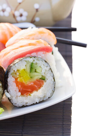 dinner with japaneese  sushi roll dish close up isolated on white background