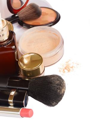 loose skin: Basic make-up products - foundation, powder and lipstick isolated on white background Stock Photo