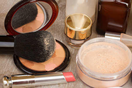 Basic make-up products - foundation, powder and lipstick photo