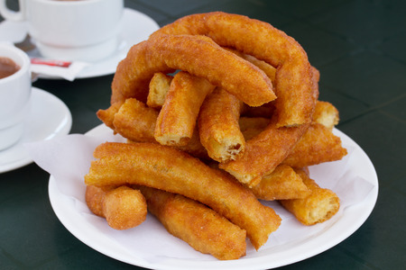 churros: traditional spanish pastry - plate of churros