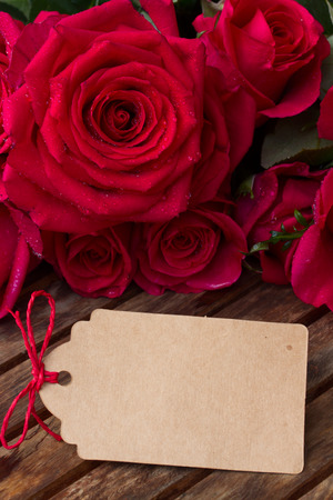 valentines day mother s: dark pink  roses with hearts and tag Stock Photo