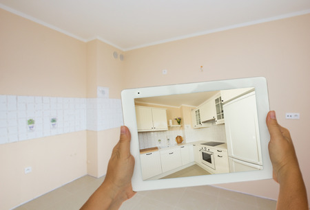 planing new kitchen on tablet photo